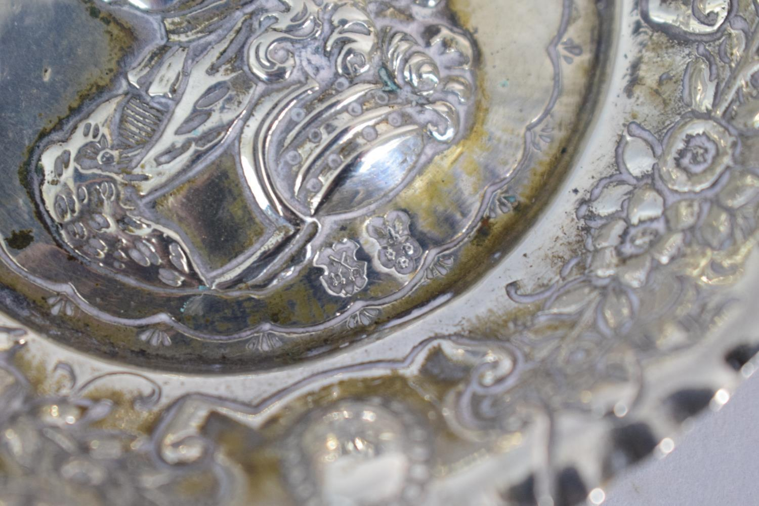 Lot 186 - An Austro-Hungarian Silver Wine Taster Decorated with the Bust of Louis I of Hungary and