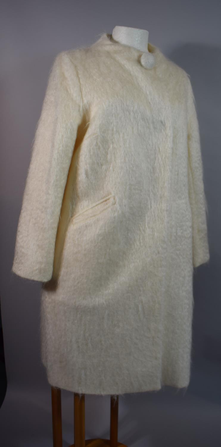 Lot 283 - An Ivory Mohair Designer Pea Coat by Milly, New York