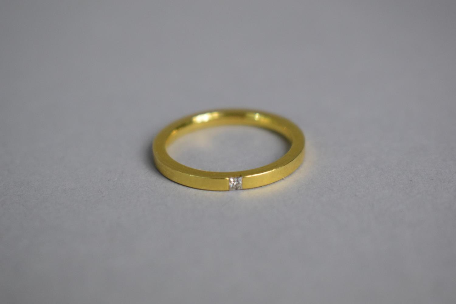 Lot 311 - A Contemporary 18ct Gold and Diamond Solitaire Ring, The Small Square Diamond Flush Set on the Band.