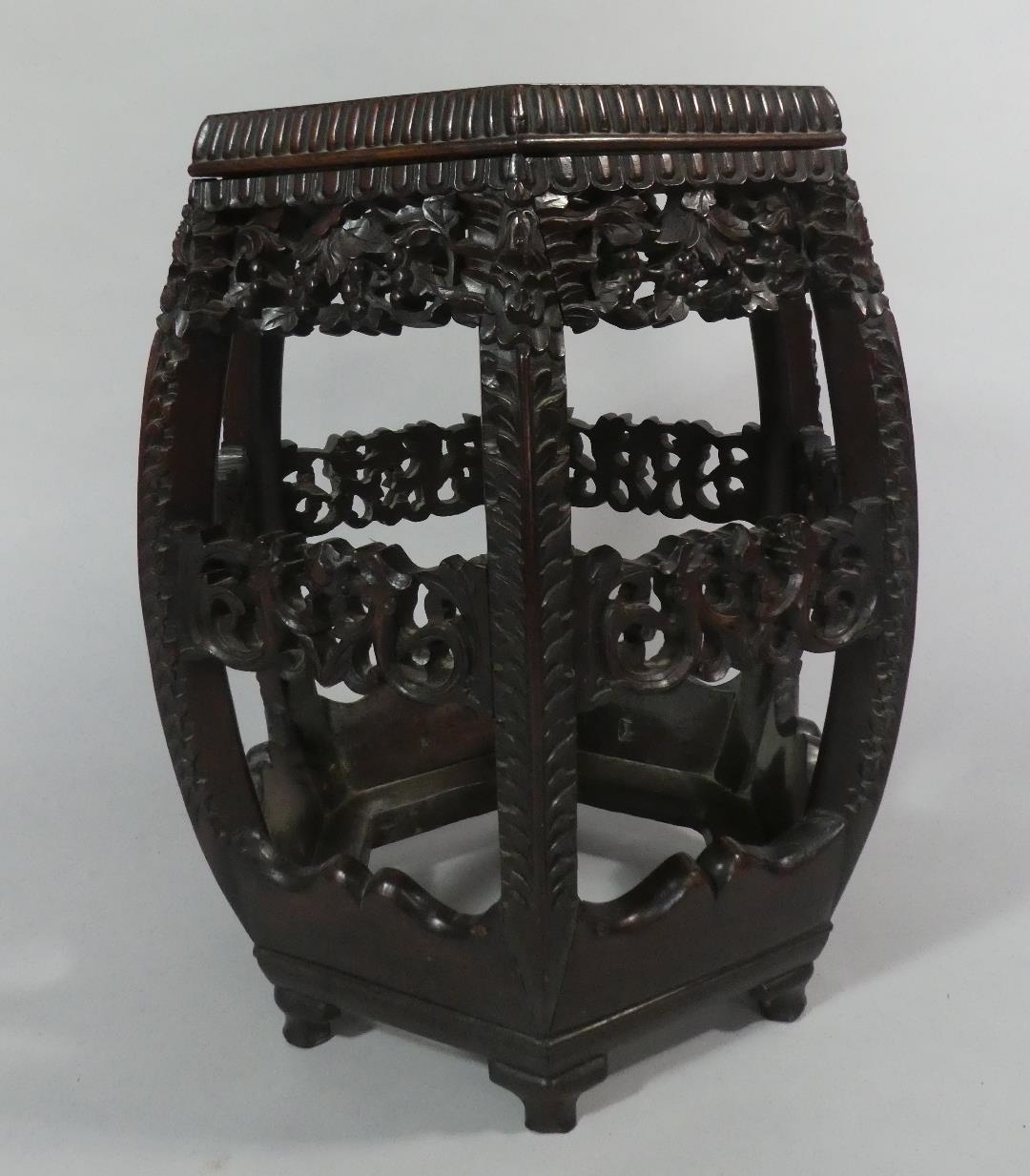 Lot 54 - A Chinese Hardwood Vase Stand of Hexagonal Form with Inset Marble Top. Carved, Moulded and Pierced