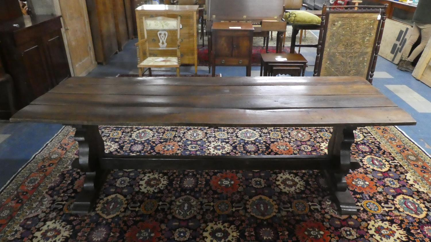 Lot 437 - A Four Plank Oak Refectory Style Dining Table. 218cms Long