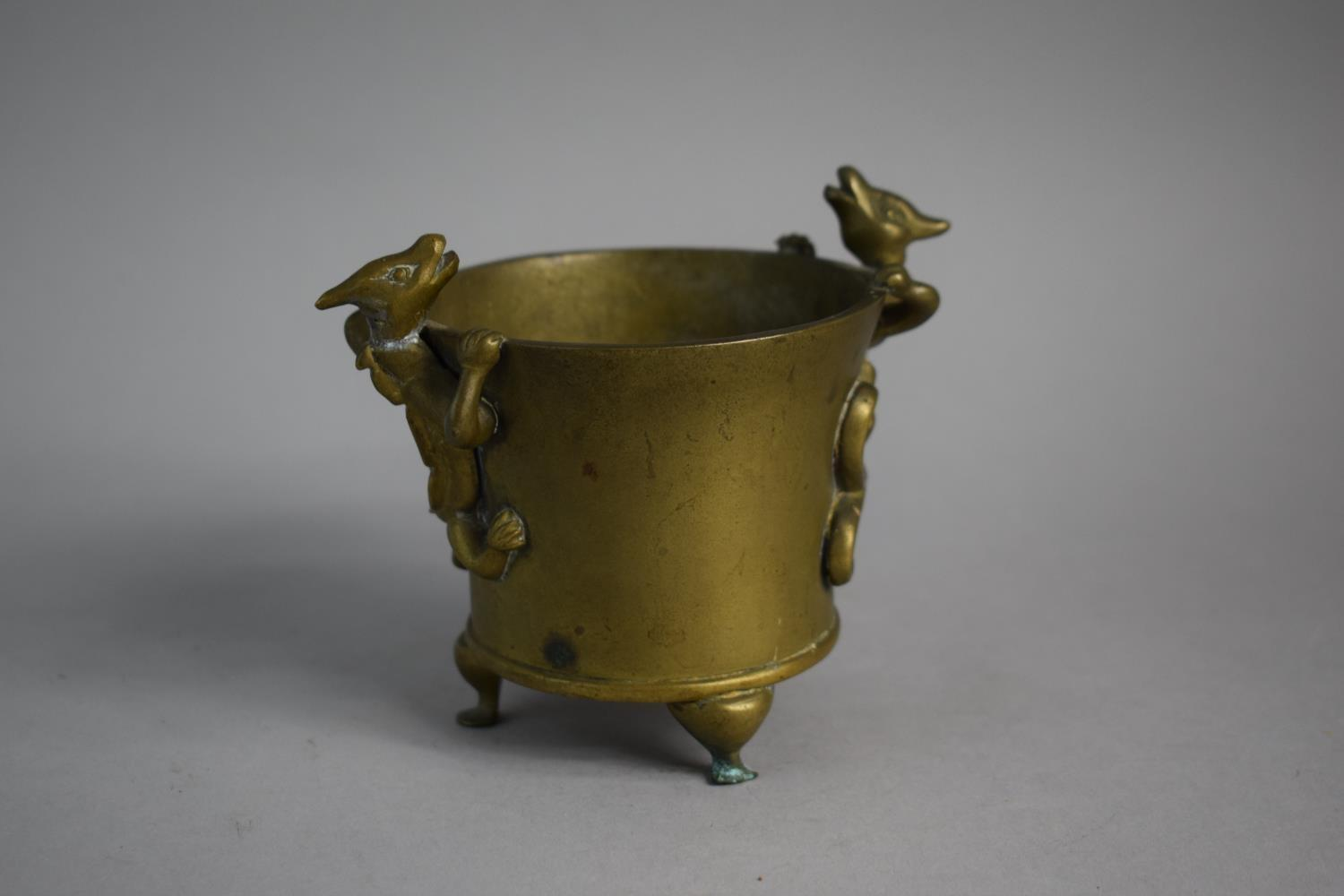 Lot 119 - A Chinese Bronze Censer on Three Feet having Pair of Climbing Dragons as Handles. Impressed Six