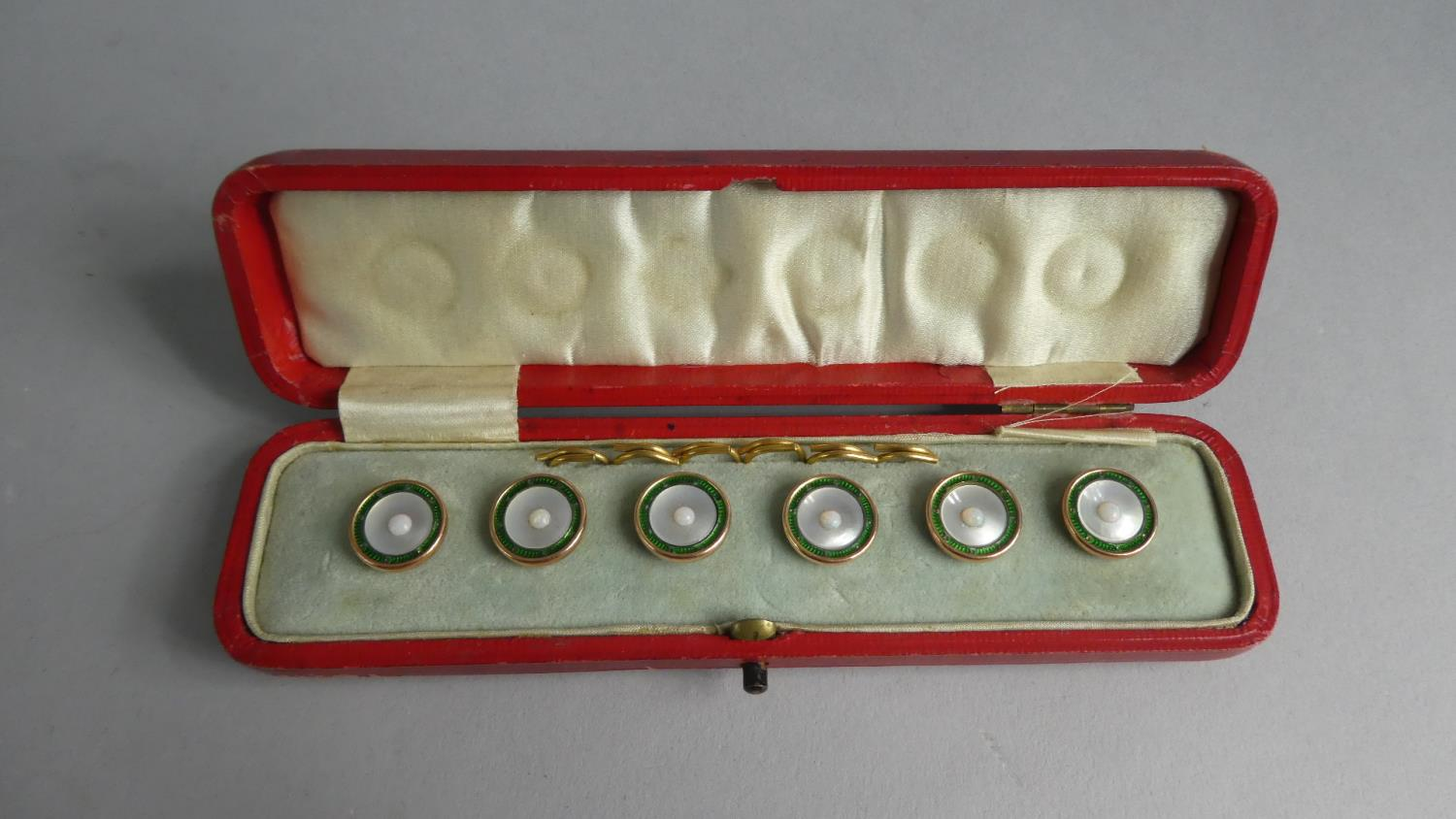 Lot 338 - A Cased Set of Six 9ct Gold, Mother of Pearl and Green Enamel Mounted Buttons, Having Centre Opal.