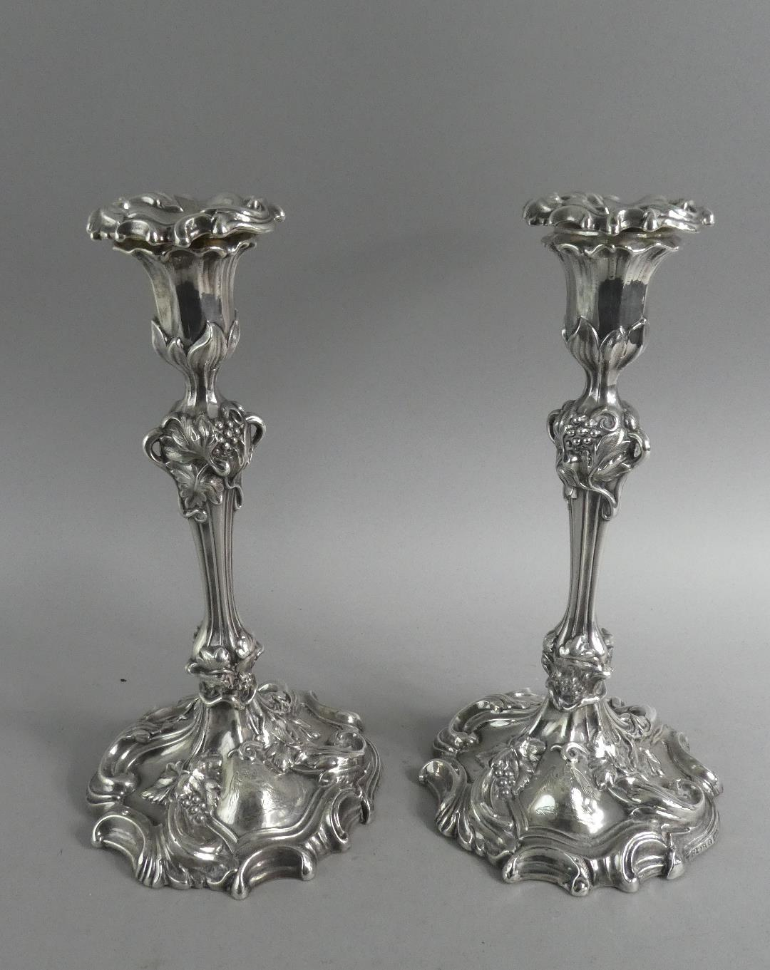 Lot 229 - A Pair of Victorian Silver Candlesticks by William Allanson of Sheffield. Chased Vine and Grape