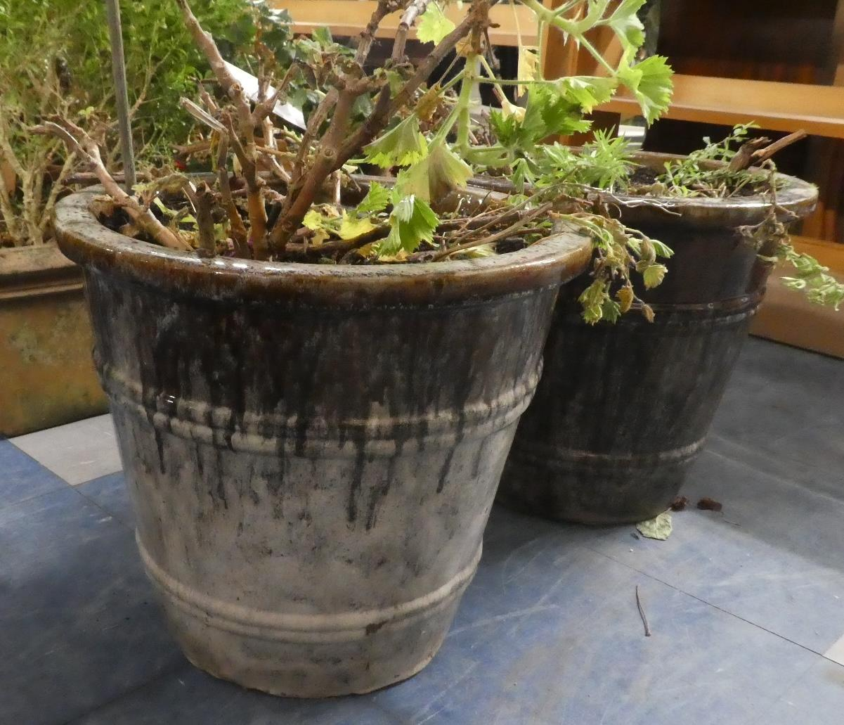 Lot 457 - A Pair of Drip Glazed Stoneware Circular Planters. 36cms Diameter