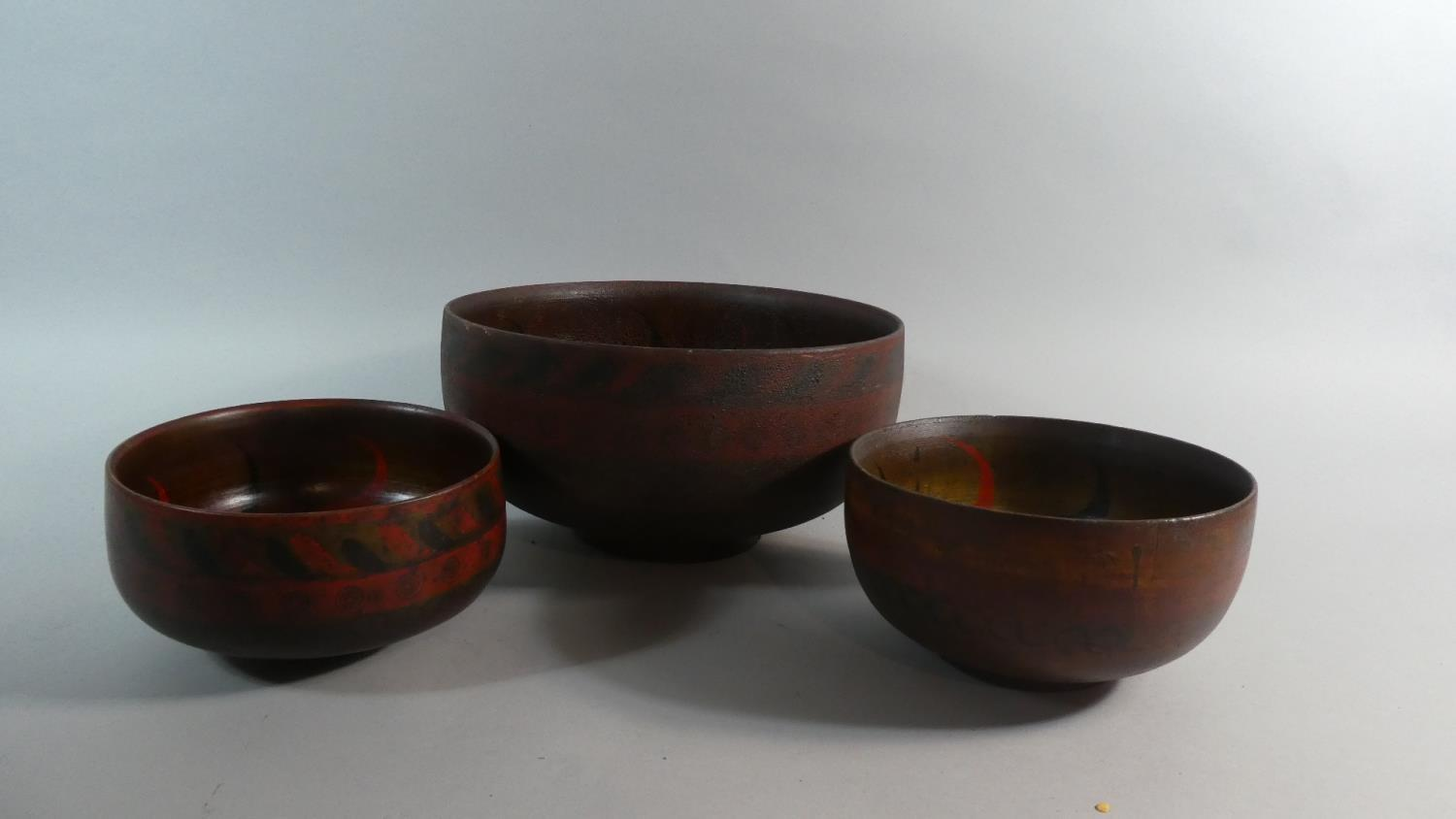 Lot 48 - A Collection of Three Early 20th Century Indonesian Wooden Bowls with Original Polychrome Painted