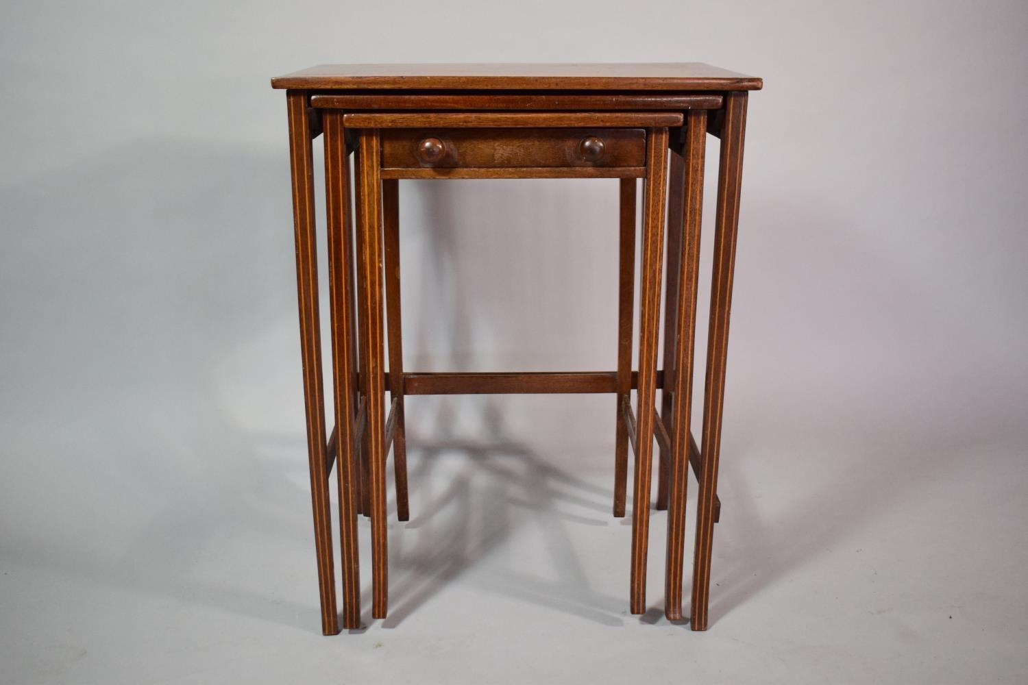 Lot 29 - A 19th Century String Inlaid Mahogany Nest of Three Tables. The Smallest Having Drawer. 51x38x64cms