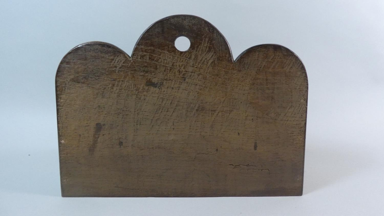 Lot 20 - A Welsh Country Made Oak Wall Hanging Spoon Rack with a Shaped Back Over Pierced Stepped Front. 33cm