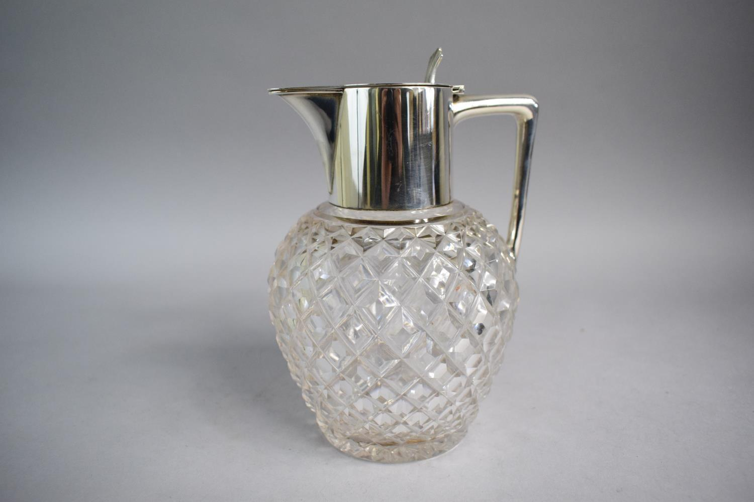 Lot 366 - A Cut Glass Water Jug with Silver Pourer and Hinged Lid. 19cms High. Birmingham Hallmark