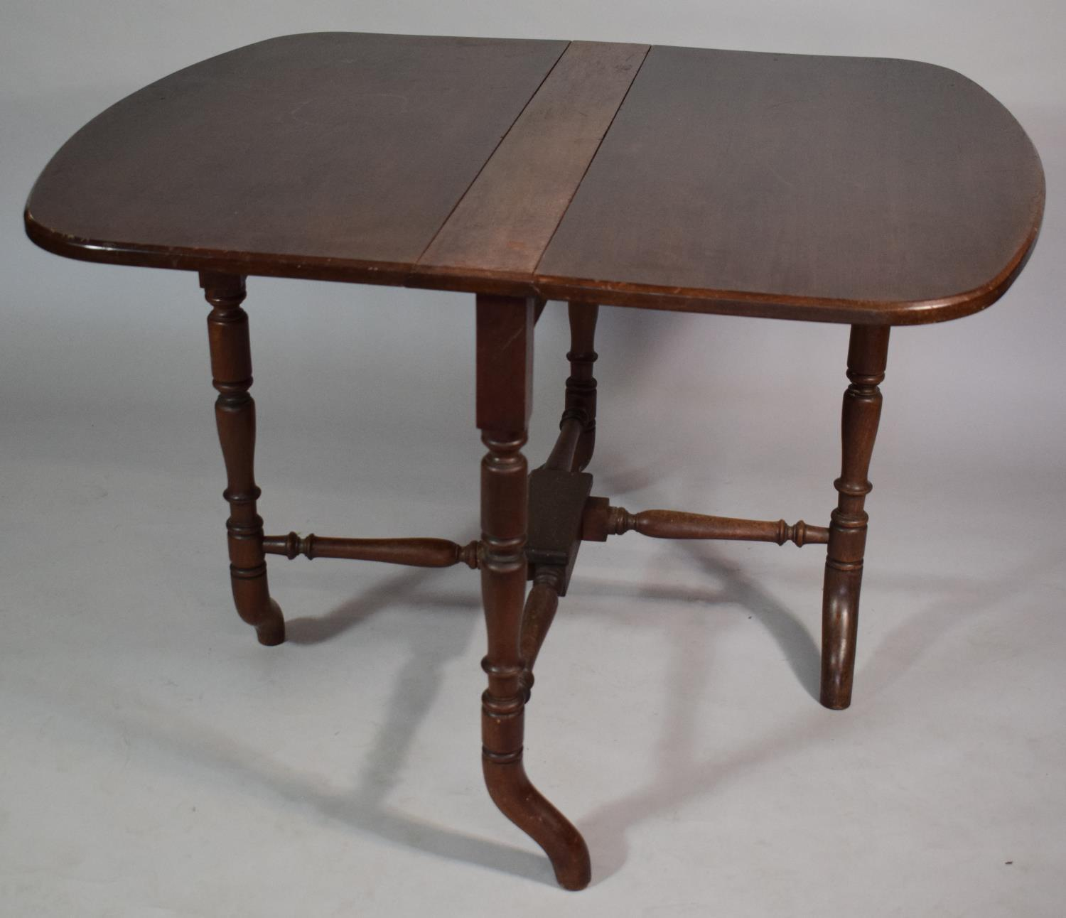Lot 479 - A 19th Century Mahogany Sutherland Table with Turned Spindle Supports. 107x91x72cms When Open