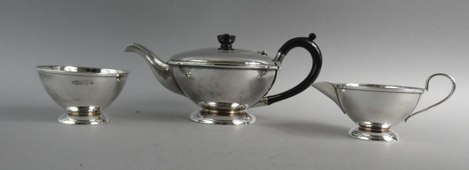 Lot 225 - A Silver Three Piece Tea Service, Sheffield 1962. 695gms Total Weight