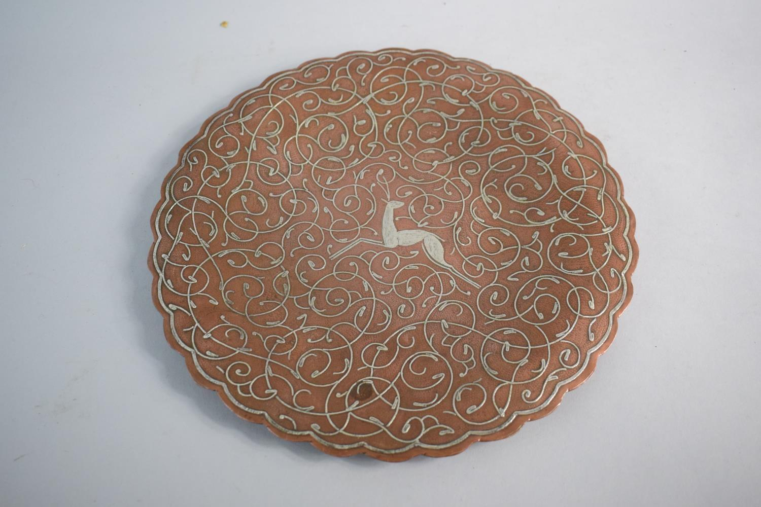 Lot 112 - A Cairo Ware Copper and White Metal Charger Decorated with Stag, 29.5cms Diameter