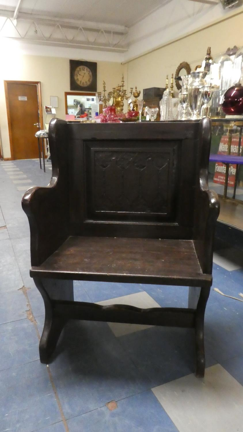Lot 78 - A Late 19th Century Stained Oak Single Pew with Carved Back Panel, 61cm high
