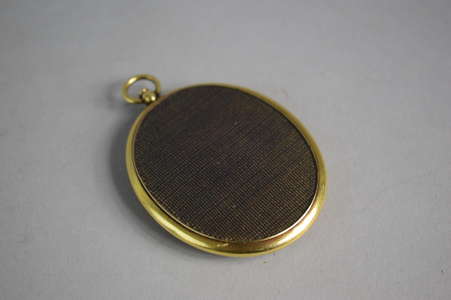 Lot 327 - A 19th Century Gold Framed Mourning Pendant with Braided Hair Verso. 6cms High