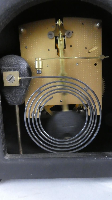 Lot 109 - An Oak Cased Mantel Clock 22cms Wide