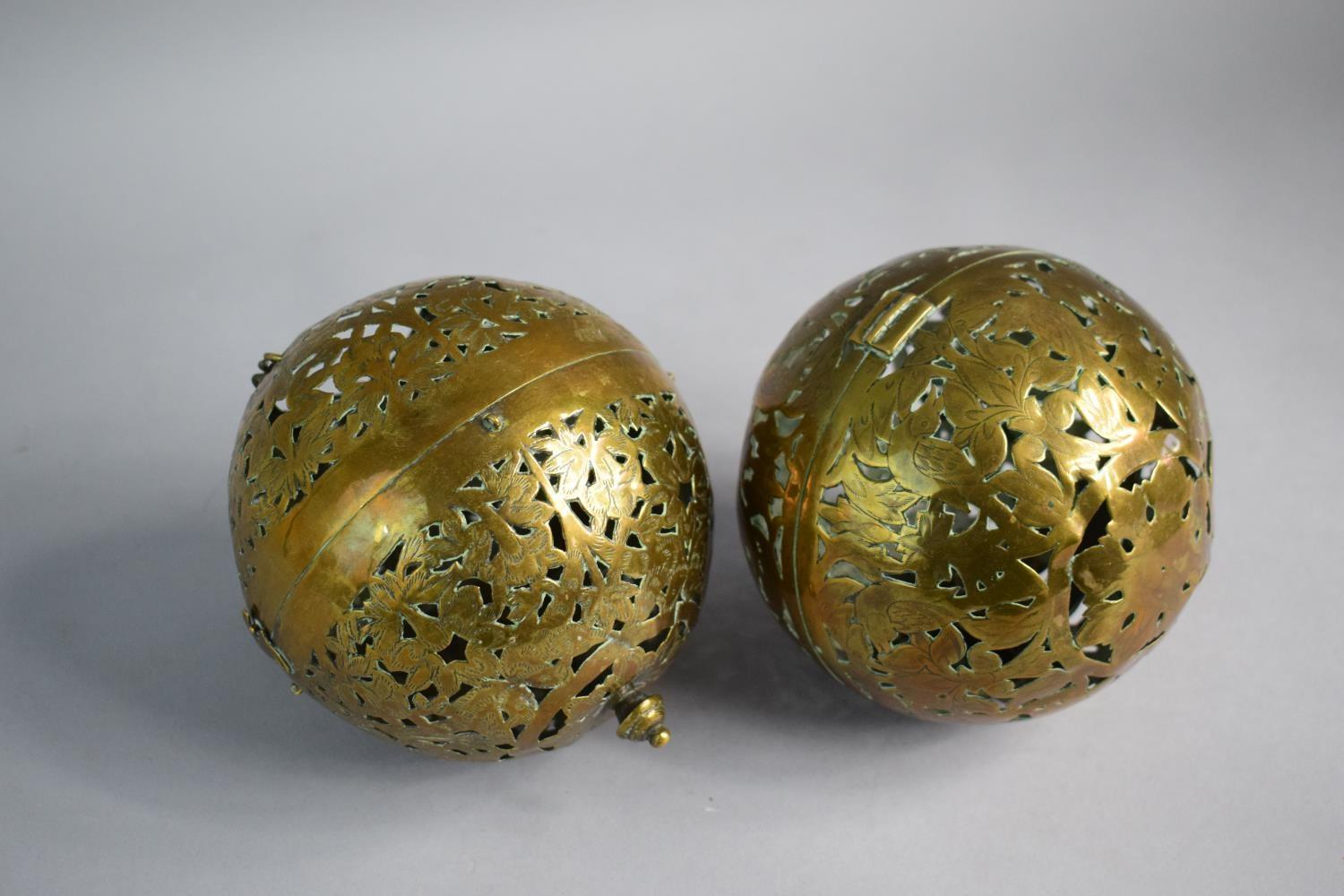 Lot 97 - A Pair of 19th Century Pierced Brass Globular Candle Holders with Hinged Joint and Bird