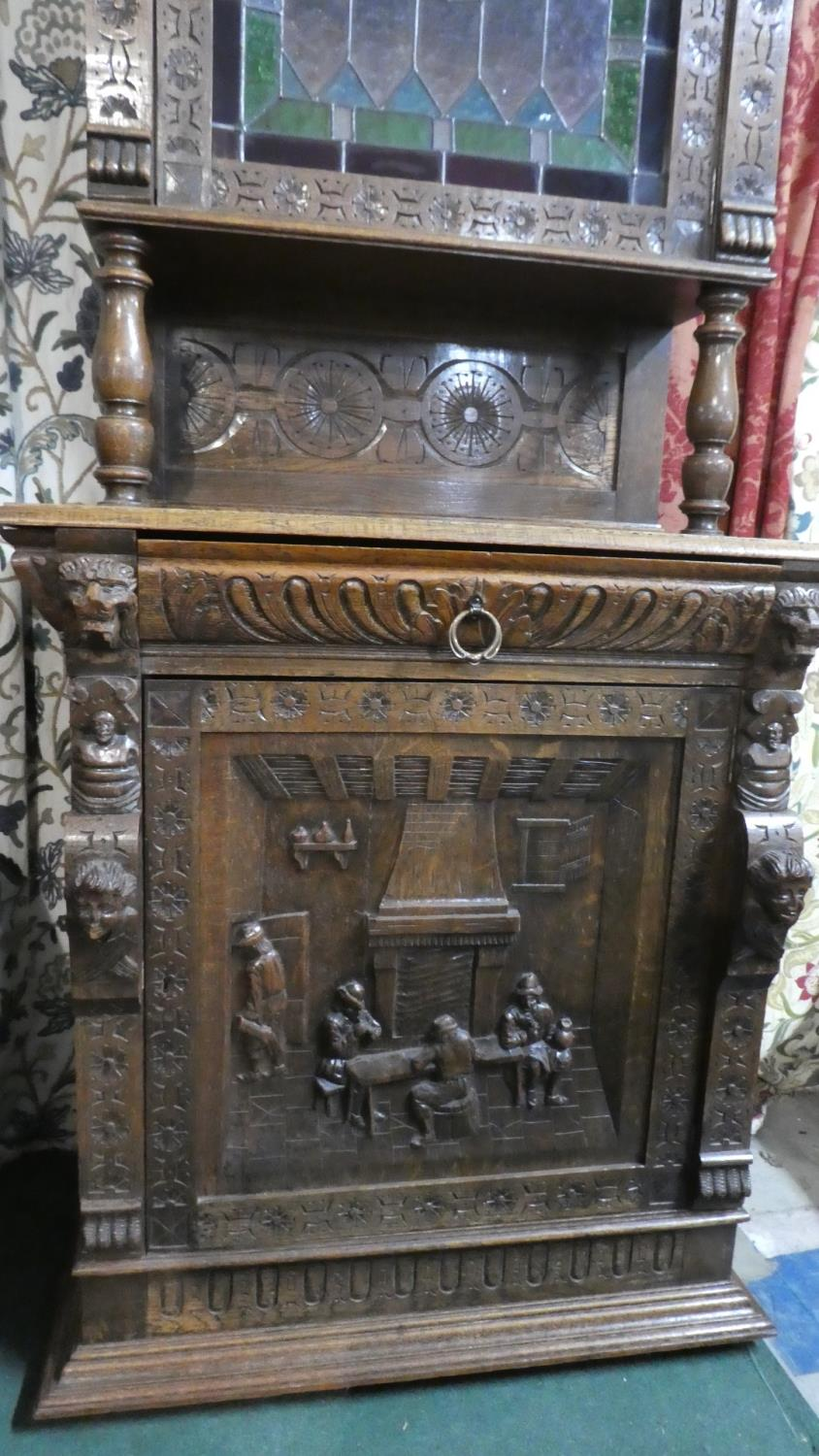 Lot 470 - A Continental Carved Oak Gothic Style Double Freestanding Cabinet with Carved Decoration having