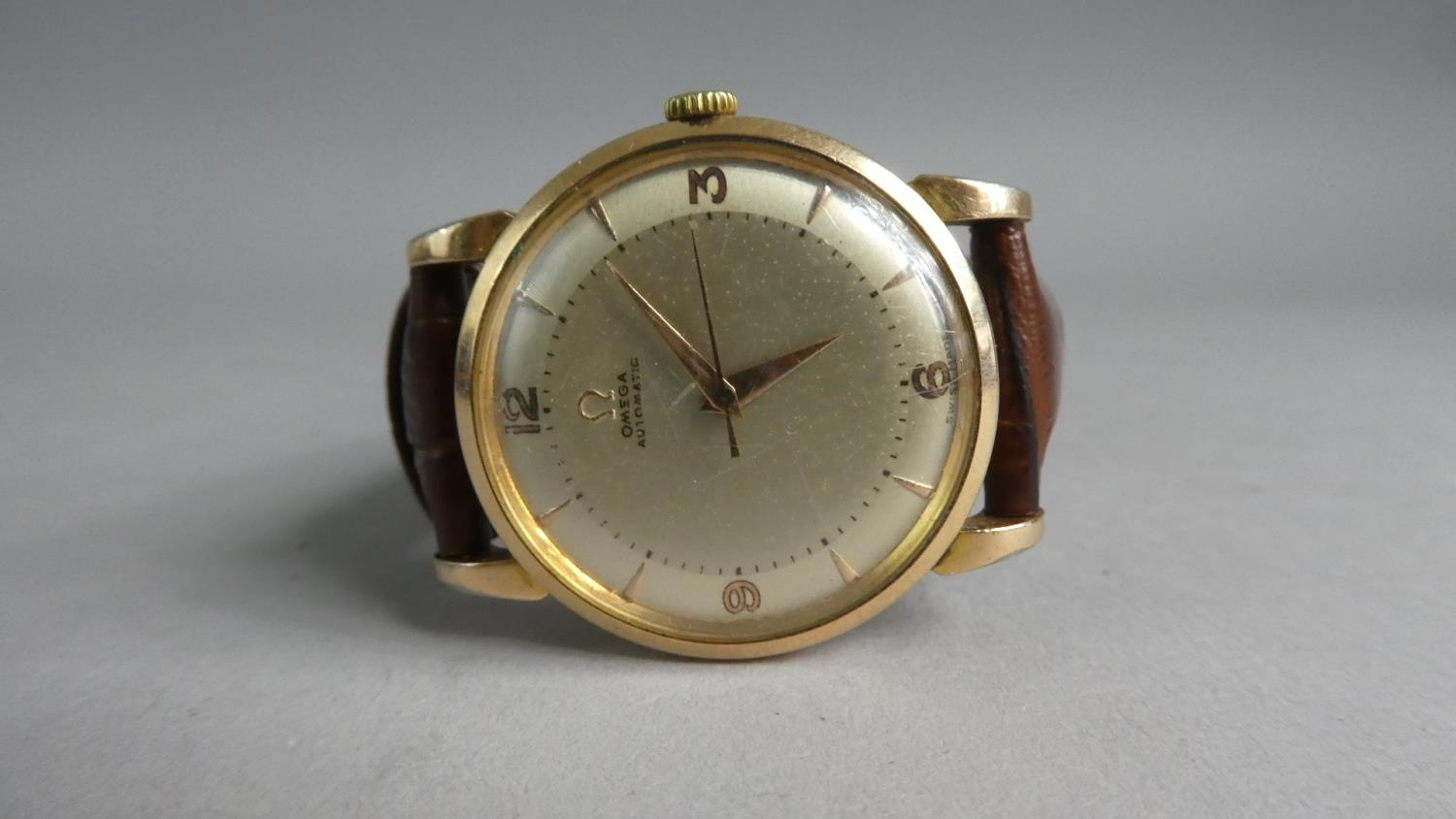 Lot 333 - A Vintage Gold Plated Omega Automatic Gents Wrist Watch, Champagne Face with Arabic Numerals and