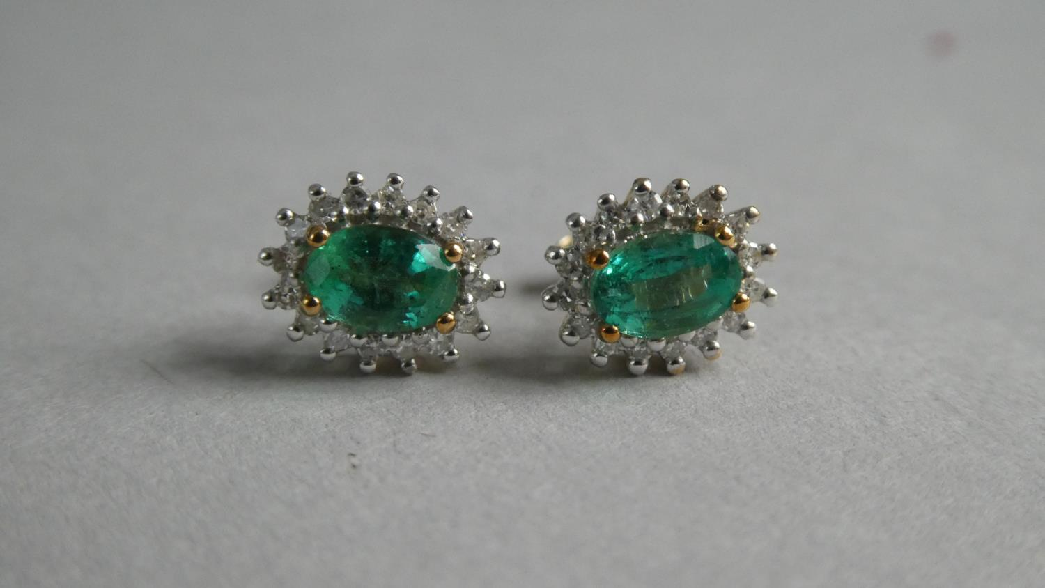 Lot 337 - A Pair of Emerald and Diamond Stud Earrings. Cushion Cut Emeralds 6mmx4mm.