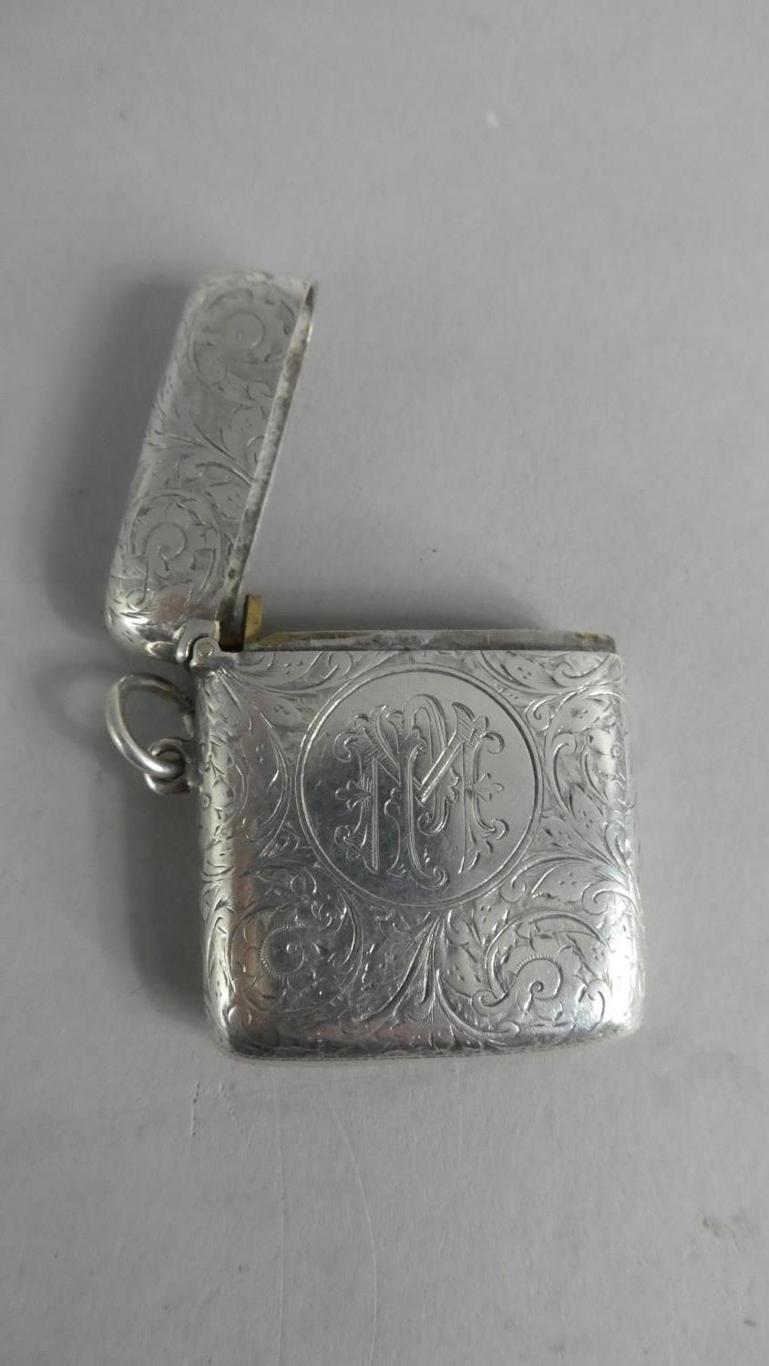 Lot 227 - A Silver Vesta with Engraved and Monogrammed Decoration. Chester 1907