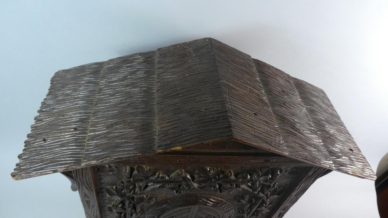 Lot 18 - A 19th Century Black Forest Carved Linden Wood Table Cabinet. 40cm x 19cm x 59cm High