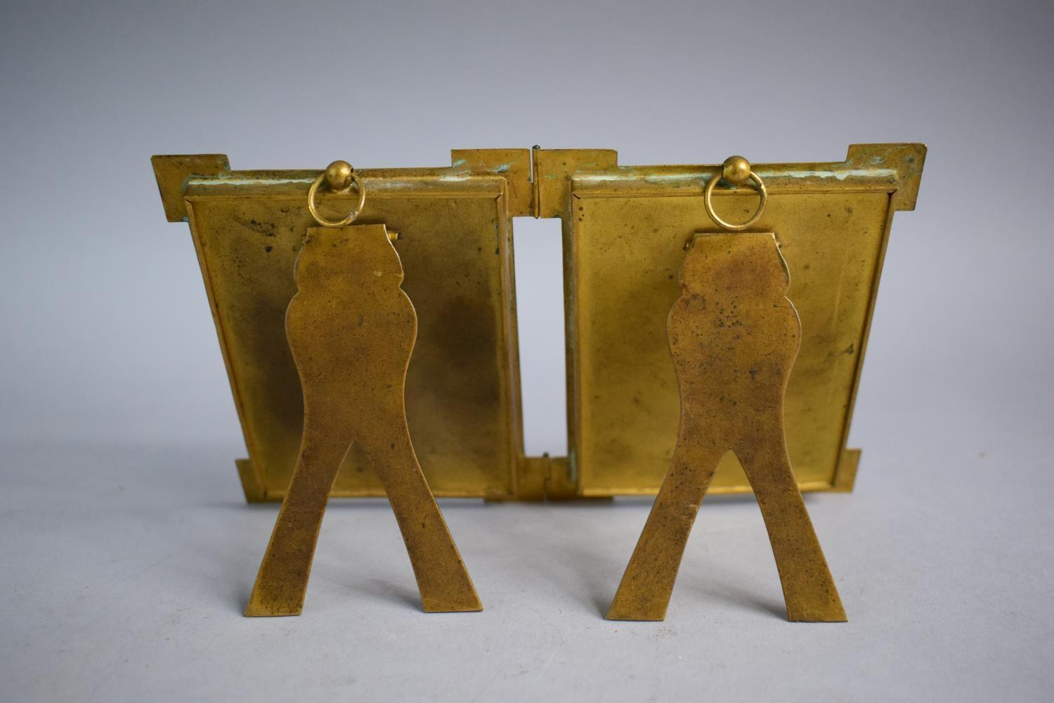 Lot 98 - An Early 20th Century Brass Hinged Pair of Photo Frames with Easel Stands, 11.5cm High