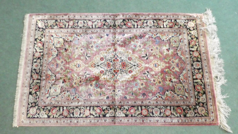 Lot 184 - A Persian Hand Made Silk Qum Rug. 125x77