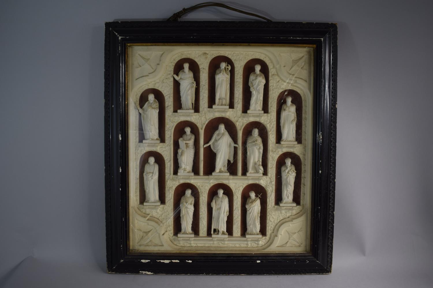 Lot 429 - A Late 19th Century Carved White Plaster Group of Christ and Twelve Apostles Set in Frame with