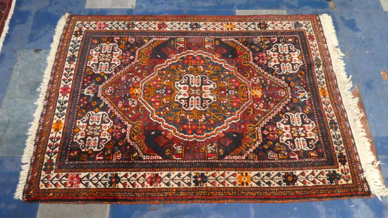 Lot 404 - A Persian Hand Made Qashqai Rug