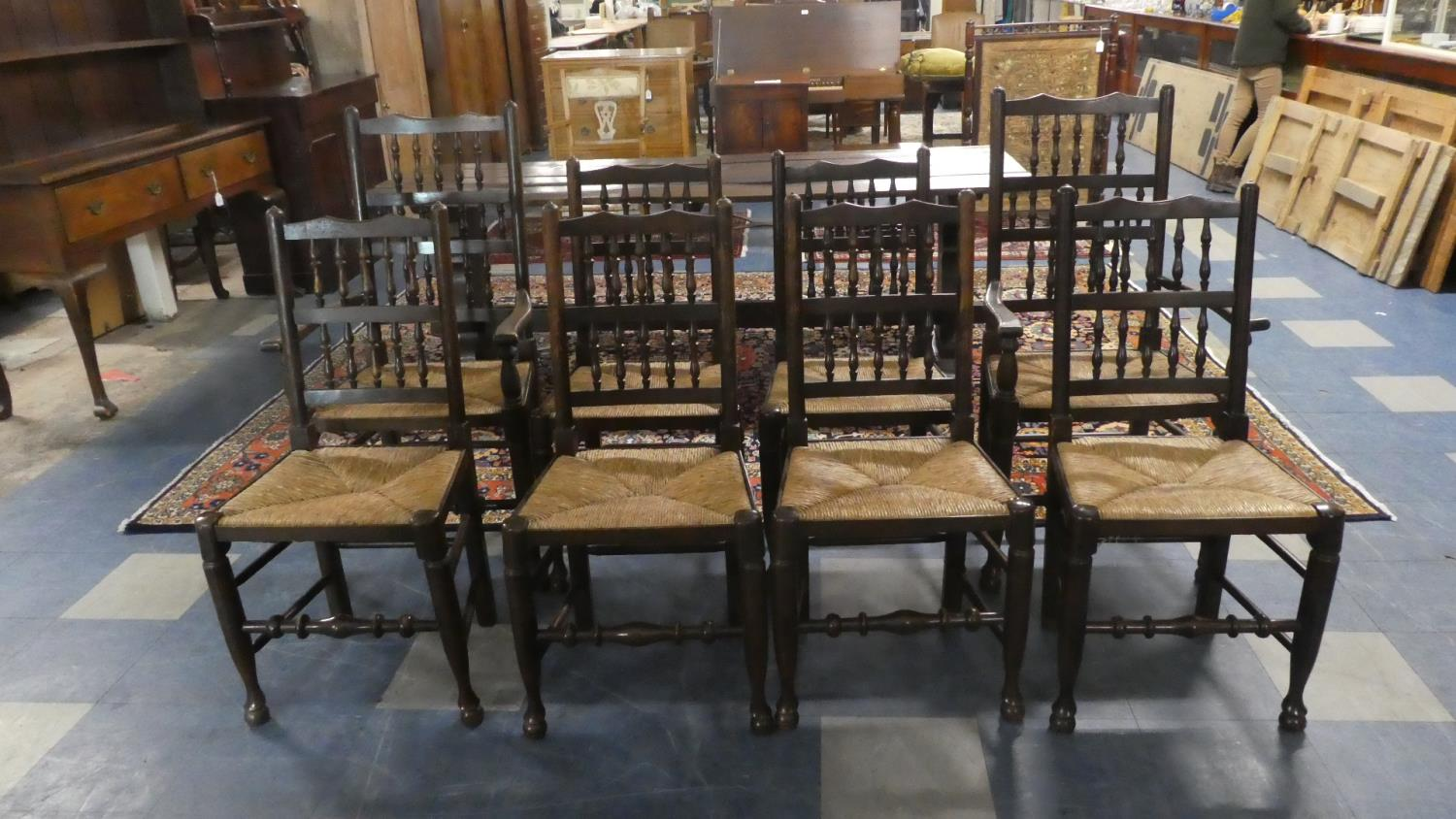 Lot 438 - A Set of Eight Rush Seated Spindle Back Dining Chairs Including Two Carvers