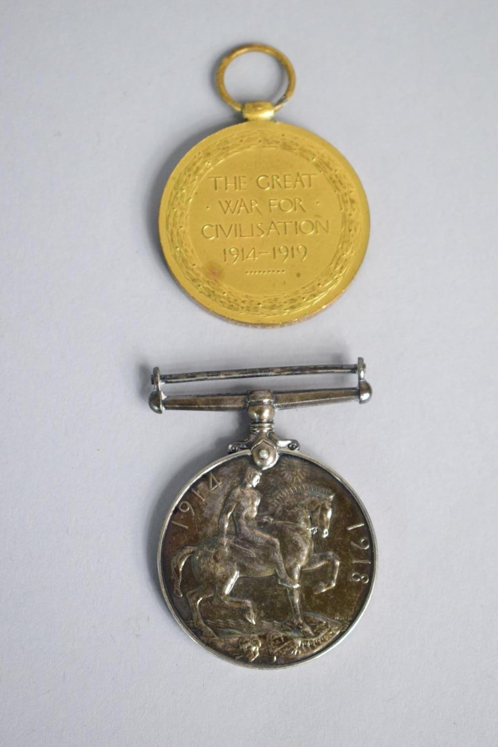 Lot 5 - A WWI Death Plaque and Two Medals For PTE. David William Griffiths, 31363 - S Wales Borderers,