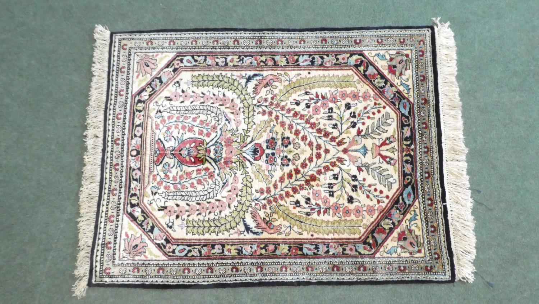 Lot 180 - A Persian Hand Made Silk Qum Rug