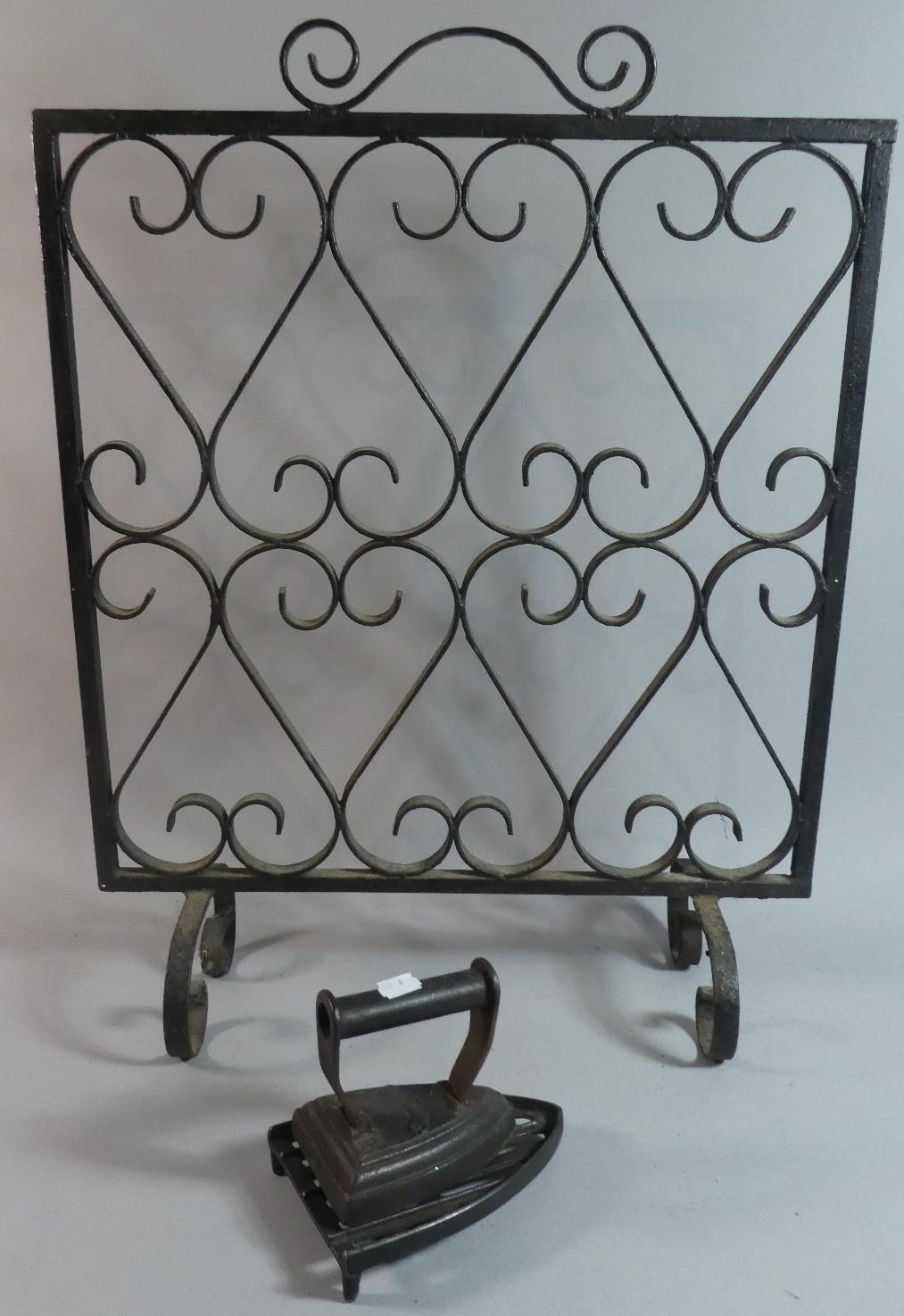 Lot 279 - A Wrought Iron Fire Screen Together with a Flat Iron and Stand