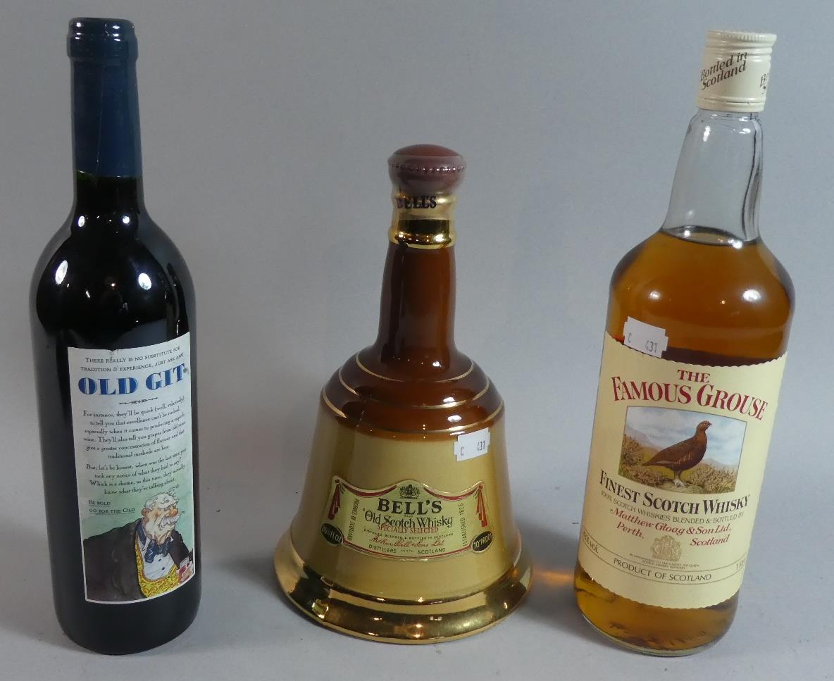 Lot 39 - A Litre Bottle of Famous Grouse Scotch Whisky, Unopened Bottle of Bells Scotch Whisky in Wade