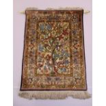 Lot 52 - A Persian silk rectangular wall hanging decorated with birds and flowers against a cream ground with