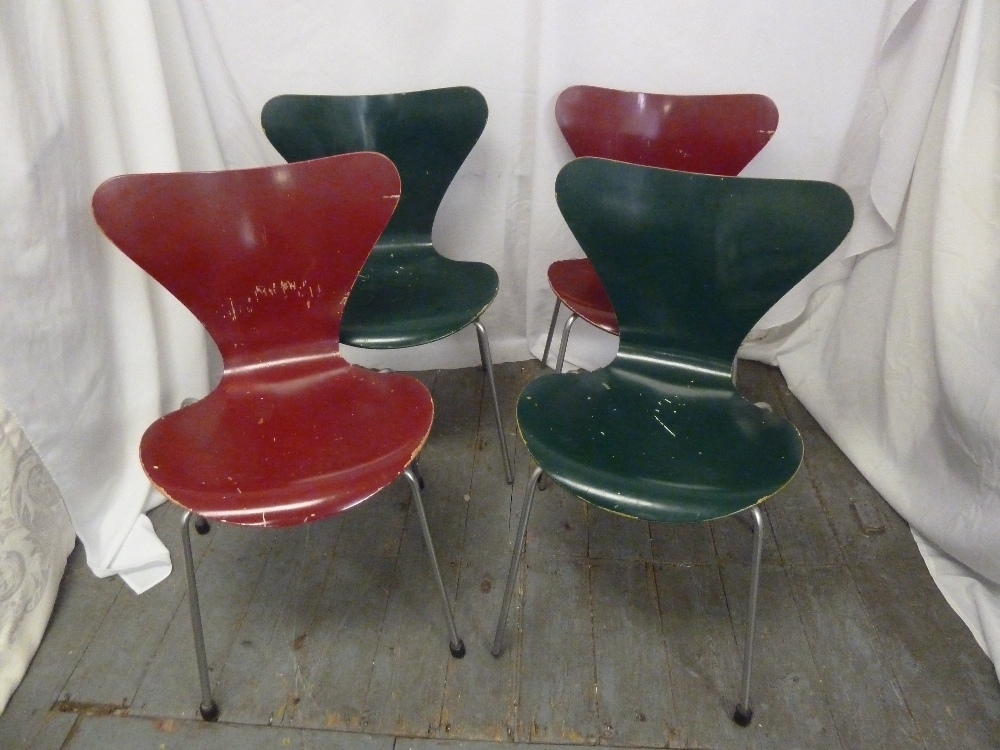 Lot 44 - Fritz Hansen a set of four dining chairs on tubular aluminium legs, makers stamp to the base, A/F
