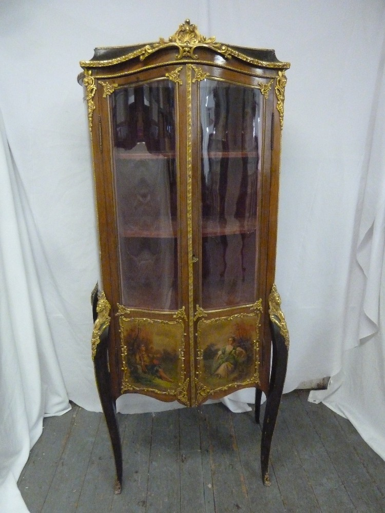 Lot 9 - A French Vernis Martin shaped oval glazed display cabinet with gilded metal mounts and panels