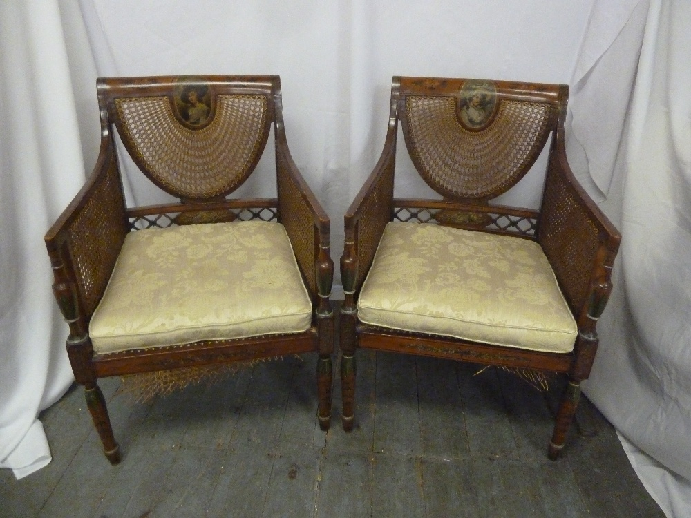 Lot 35 - A pair of early 20th century Sheraton style bergere armchairs with eighteenth century style