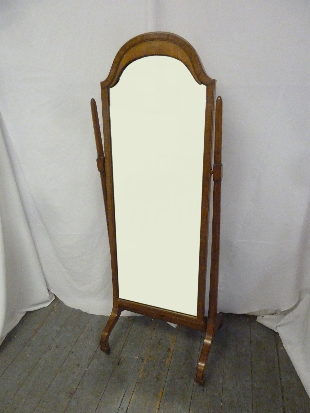 Lot 47 - An Edwardian cheval mirror rectangular with arched top, oak frame and support