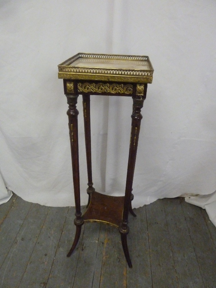 Lot 14 - A rectangular mahogany square plant stand with marble galleried top, on four outswept legs