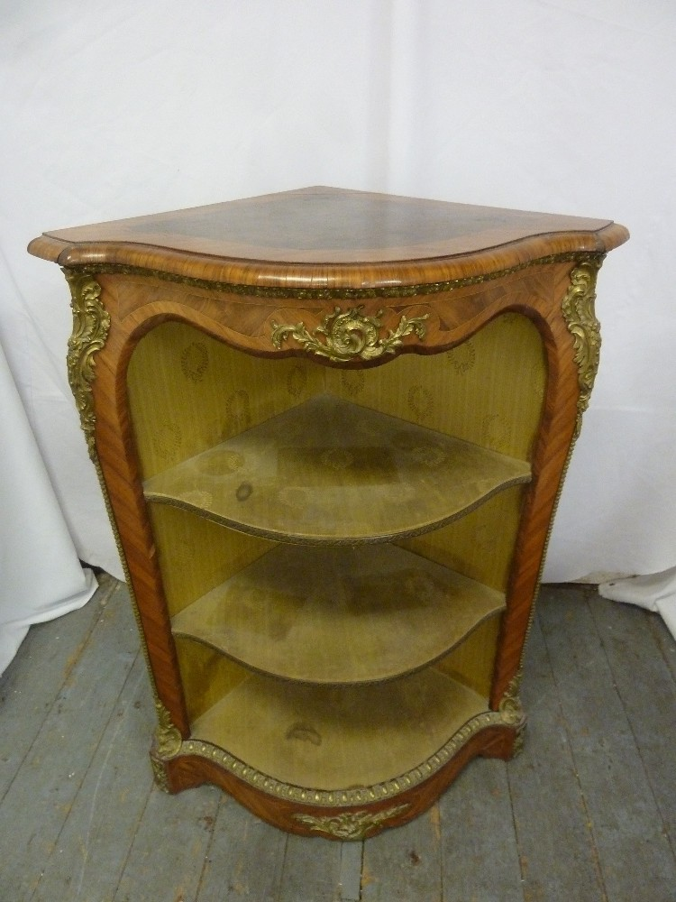 Lot 7 - A Louis XVI style corner unit of triangular form with three shelves and applied gilded metal mounts