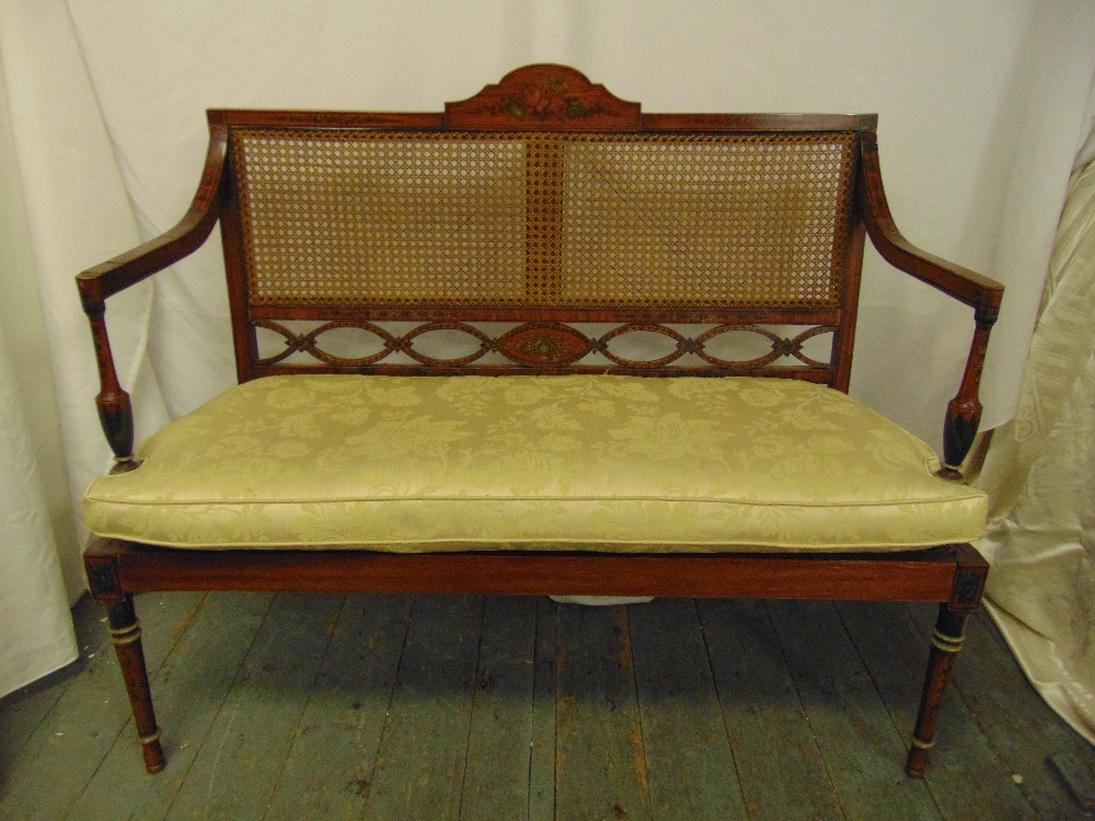 Lot 36 - An Edwardian rectangular two seater Sheraton style settle with bergere back and seat on four