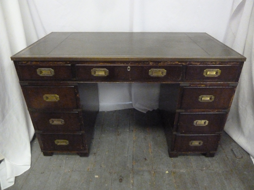 Lot 4 - A rectangular mahogany pedestal desk with inset brass handles and tooled leather top