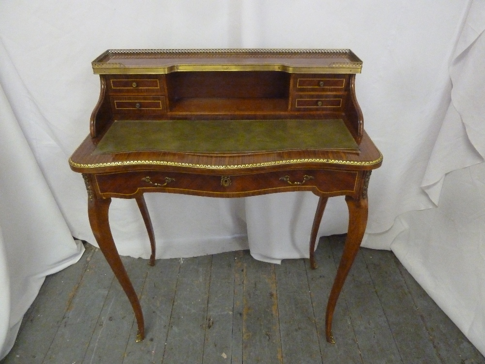 Lot 5 - A Louis XVI style rectangular desk with gallery shelf, on four cabriole legs
