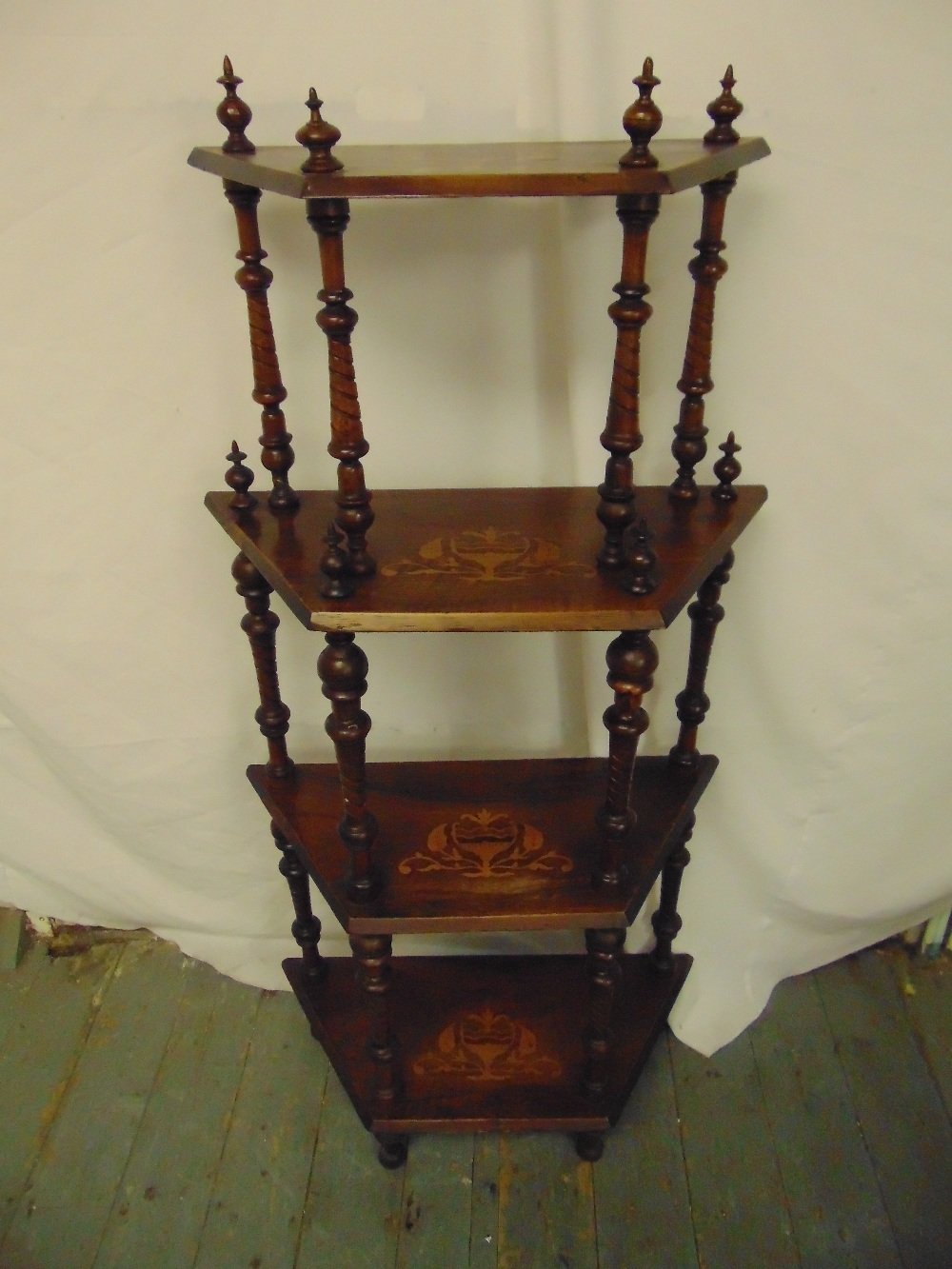 Lot 26 - A Victorian four tier mahogany whatnot with turned baluster columns on four block feet
