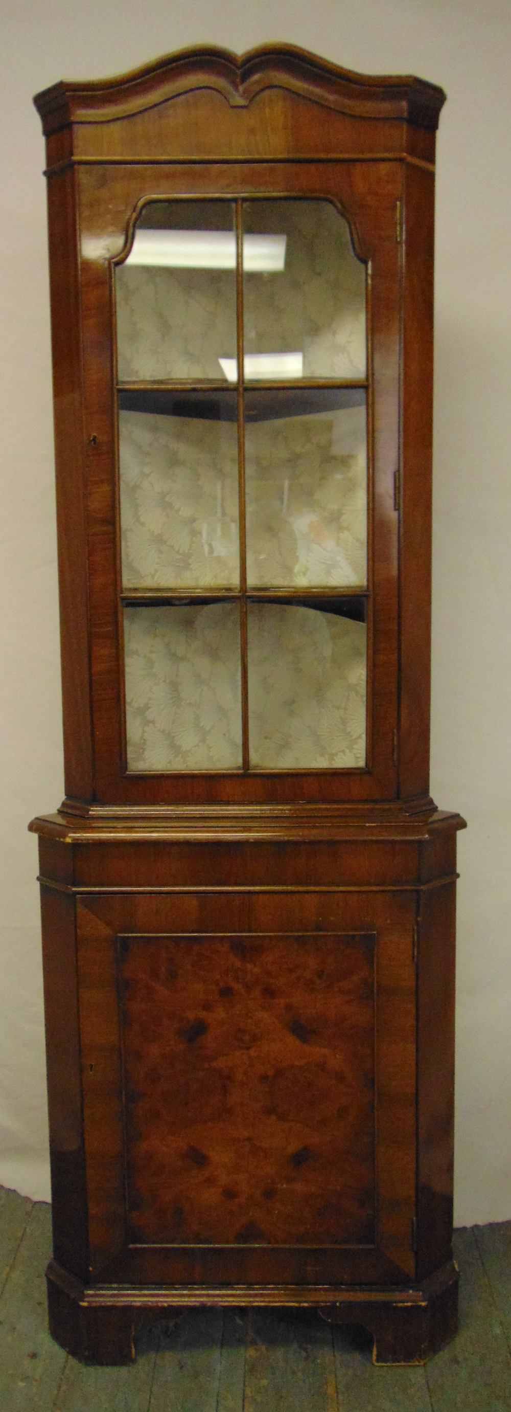 Lot 14 - An Edwardian mahogany glazed corner cabinet on four bracket feet