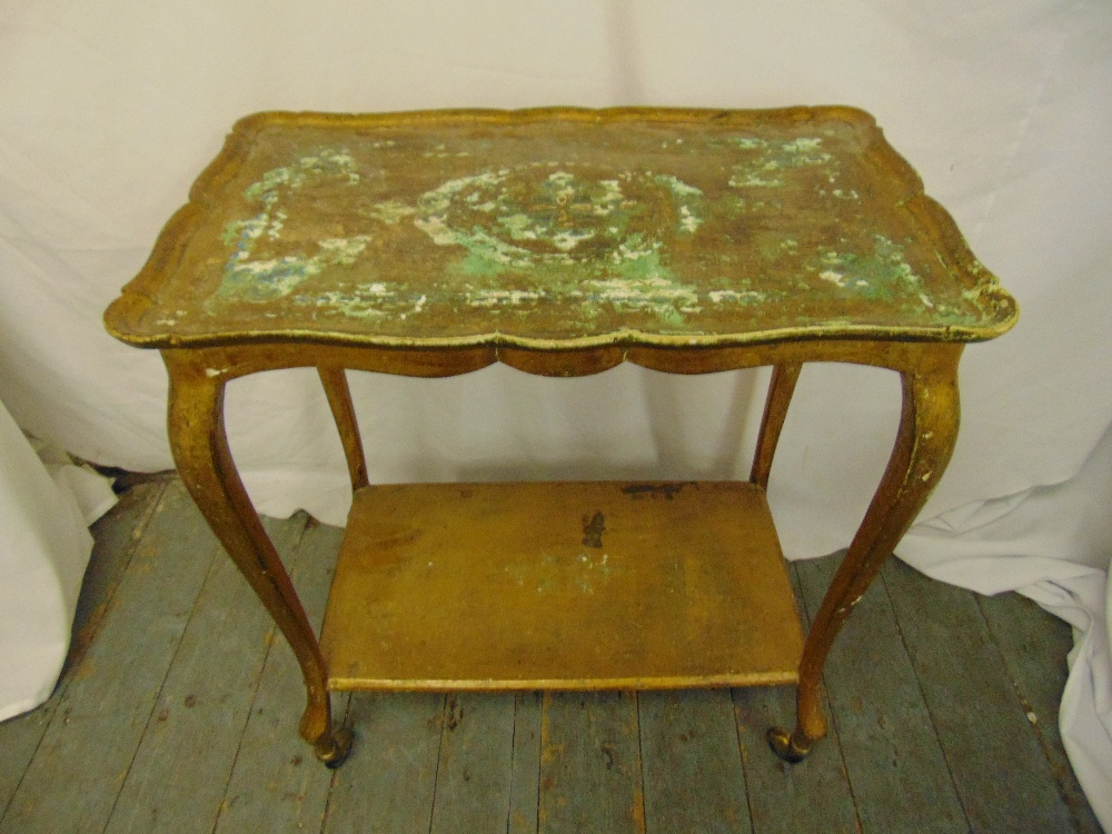 Lot 33 - A gilded wooden shaped rectangular tea trolley with cabriole legs to include original castors, A/F