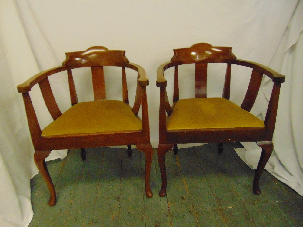 Lot 47 - A pair of mahogany armchairs with upholstered seats, slatted backs, on cabriole legs