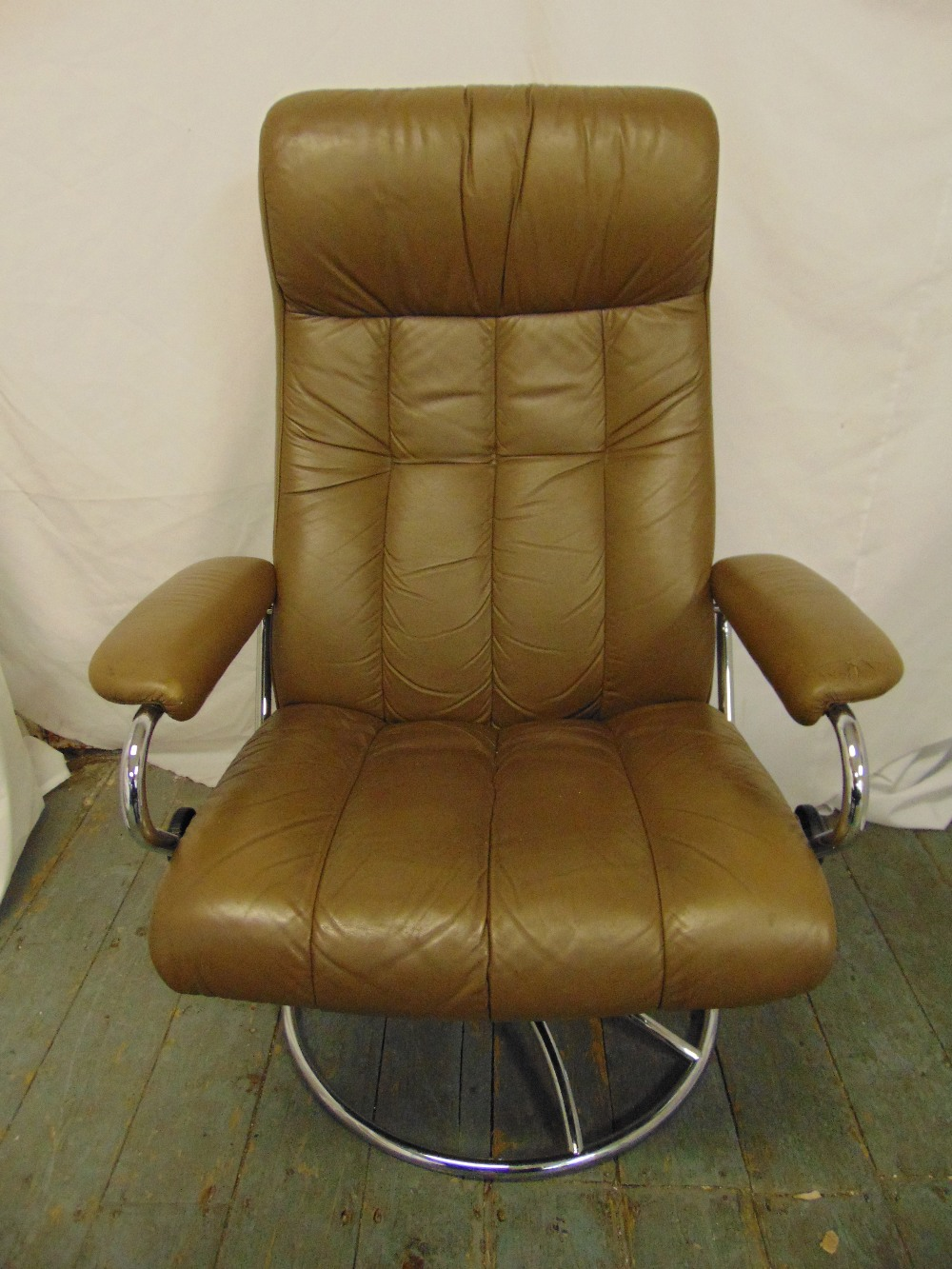 Lot 50 - A 1980s leather and chrome armchair revolving recliner