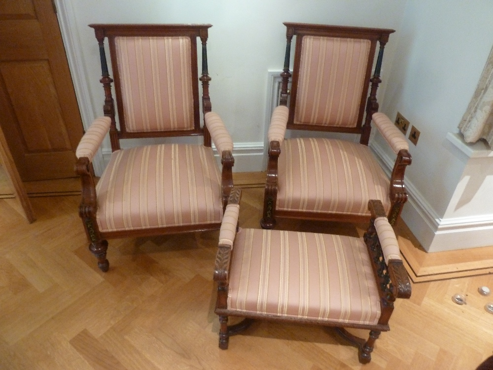 Lot 42 - A pair of mahogany upholstered occasional chairs and a matching foot stool